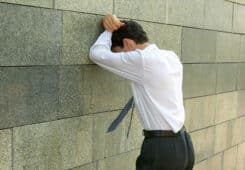 Man Facing Wall