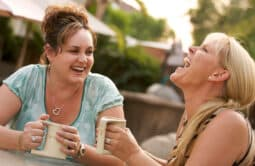 Two Women Talking & Laughing